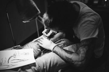 tattoo master stuffing a tattoo