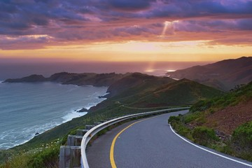 Beautiful colorful sunset viewed from the costal road, pacific coast near San Francisco, United States of America Wall mural