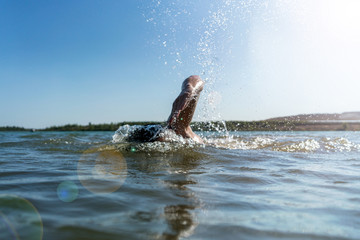Man swimming in a lake background