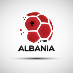 Abstract soccer ball with Albanian national flag colors
