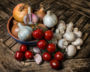 An arrangement of healthy fresh raw food on a wooden background.