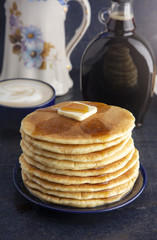 Stack of Freshly Made American Style Pancakes with Metling Butter