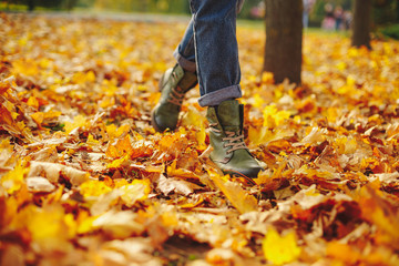 Leather shoes walking on fall leaves Outdoor