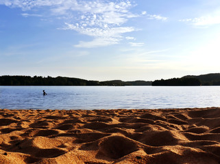 Beach in Sandared, Sweden during Summer. Clean water and warm sand at this little place by the lake.