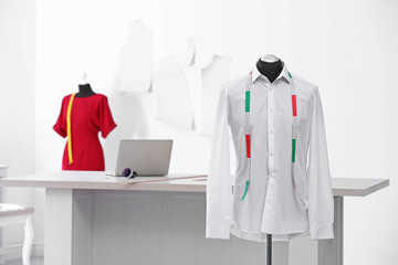 Mannequin with shirt and measuring tape in tailor studio