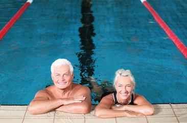 Sportive senior couple in indoor swimming pool