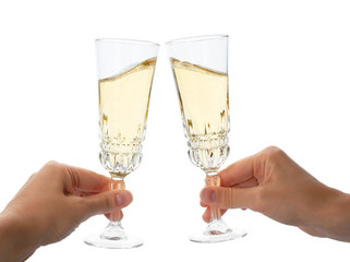 Women toasting with glasses of champagne on white background