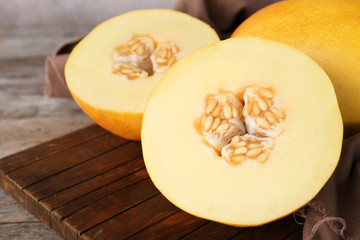Sliced ripe sweet melon on wooden table