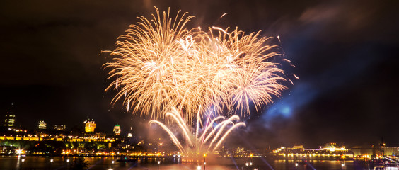 Gold fireworks during a summer festival in Quebec City, Canada.