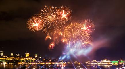 Gold/Orange fireworks during a summer festival in Quebec City, Canada.