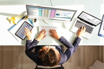 Businesswoman Doing Multitasking Work In Office
