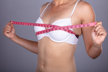 Woman Checking Her Breast Measurement