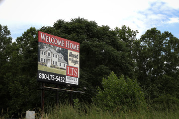 A sign advertises real estate in East Stroudsburg