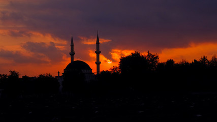red sunset over the mosque