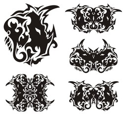 Abstract horned dragon head and butterflies formed from it. Scary ethnic dragon head in the form of a butterfly wing and the wings of butterflies created from her. Black on white