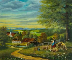 Schafe in einer Blumenwiese vor einer Ortschaft