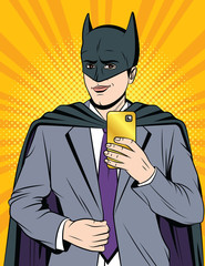 Vector color comic pop art style illustration of a handsome guy in a superhero costume making a selfie. An office worker takes a picture of himself on the phone in a masquerade suit