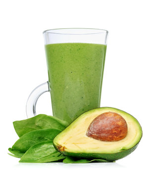 Green smoothies in a glass with avocado
