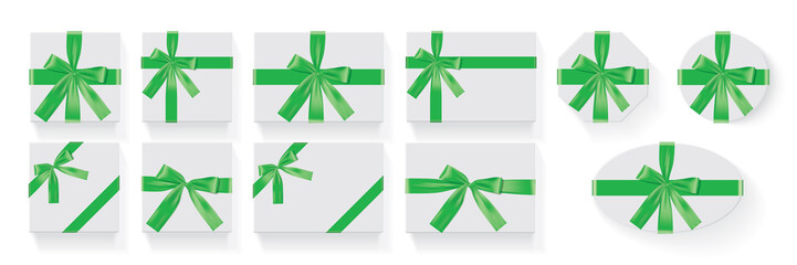 different shapes of boxes with a green bow