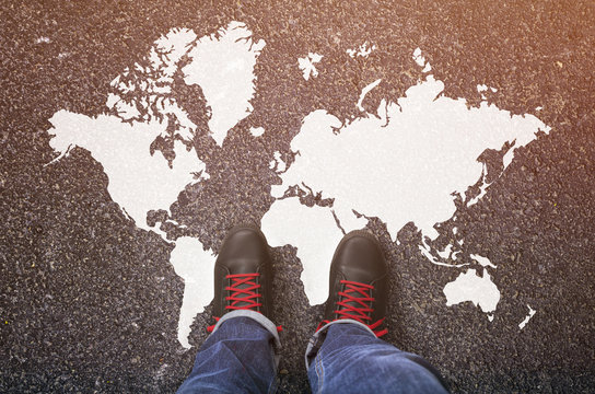 World map on an asphalt road