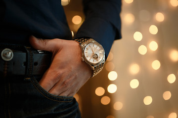 closeup designer watch on businessman hand