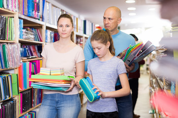 parents and child choosing school stationery
