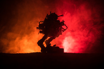 Silhouette of Giant robot. Futuristic tank in action with foggy fire sky background