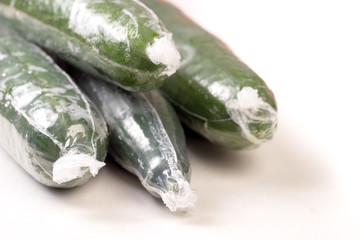 Bunch of cucumber wrapped in plastic films