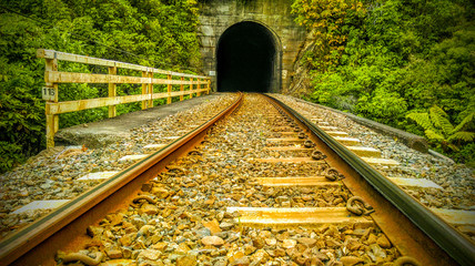 abonded railroad track in new zealand tunnel perpespective