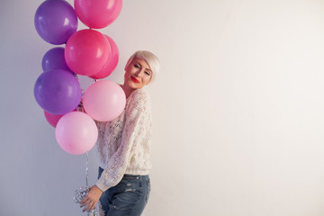 blonde woman nice gifts and balloons brought 1