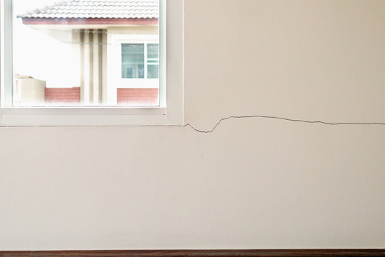 New house wall crack near window frame