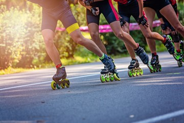 Inline roller skaters racing in the park o
