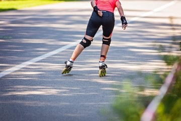 Young woman roller skating in the park