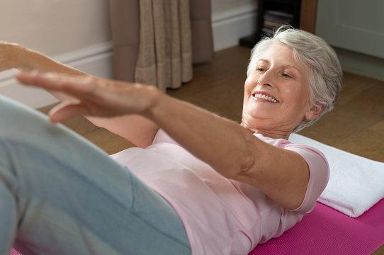 Senior woman doing abs