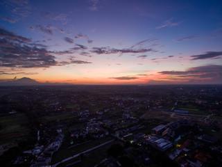 sunrise over canggu bali indonesia ocean waves aerial shot vulcano