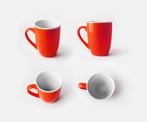 Red ceramic cups. Mugs for coffee or tea. Responsive design mockup. Template for placing your design.