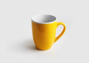 Blank yellow mug for coffee or tea. Cup mock-up.