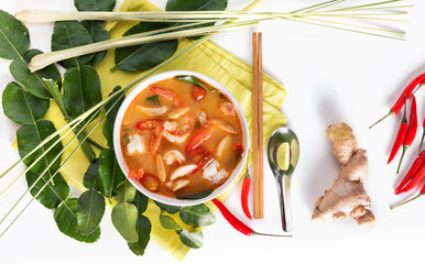 Thai Tom Yum Goong or spicy tom yum soup with prawns shrimps