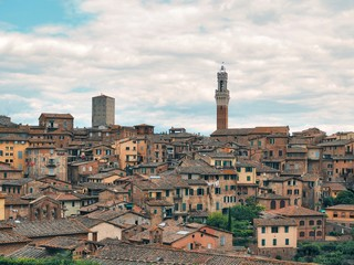 Panorama of the medieval city of Siena in Tuscany, here you can see the towers of cathedrals and roofs
