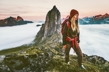 Woman with backpack hiking in sunset  mountains adventure outdoor in Norway active vacations traveling lifestyle Segla peak Fototapete