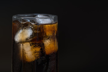 Close up detail of a chilled glass of coke
