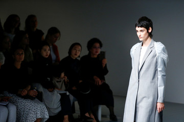 Models present creations at the J. JS Lee catwalk show at London Fashion Week Women's