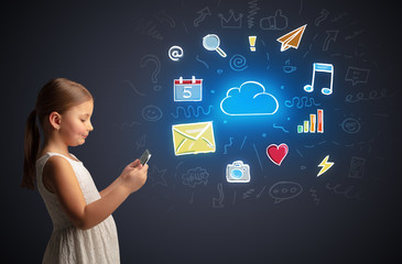 Adorable girl working on tablet with application and gadgets concept