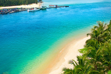 beautiful view of the lagoon with white sand and palm trees, turquoise sea. view from the top.