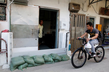 Sandbags are put in front of a home at Lei Yue Mun, a village as one of the several areas at-risk, as Typhoon Mangkhut approaches Hong Kong