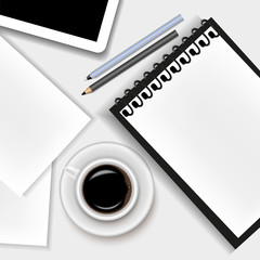 Vector image of a realistic office background. A cup of coffee, a notepad, a tablet, a pen, a pencil and a sheet of paper lying on the table