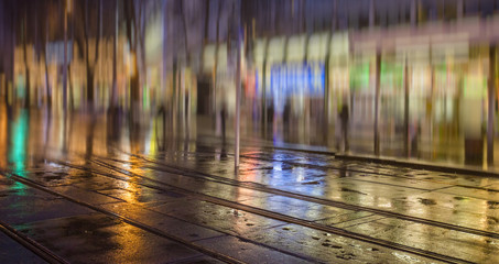 Fotomurales - silhouette of colorful people on the rainy night street