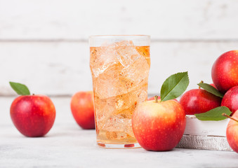 Tuinposter Bier / Cider Glass of homemade organic apple cider with fresh apples in box on wooden background. Space for text