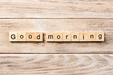 good morning word written on wood block. good morning text on table, concept