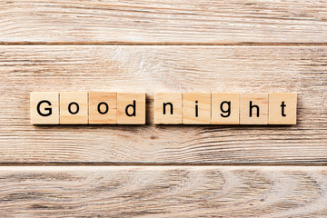 good night word written on wood block. good night text on table, concept